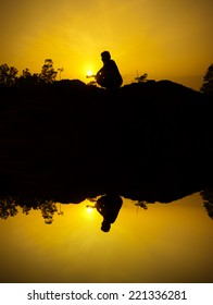 silhouette and reflection of people at sunrise