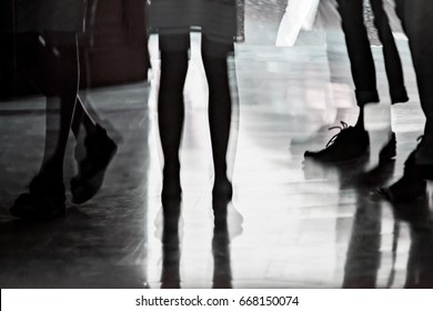 Silhouette and reflection of walking and standing people, abstract concept for street life and street photography