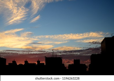 Silhouette of residential buildings at sunset
