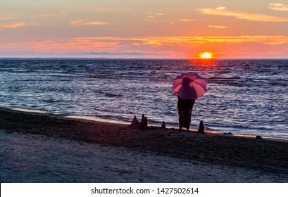Silhouette of resting woman at a beach of Jurmala - famous international Baltic resort in Latvia, Europe