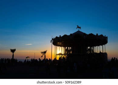Silhouette of a retro carousel at sunset, Lacanau, France