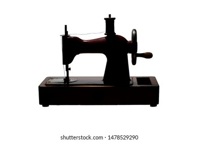 Silhouette of a retro sewing machine with a spool of thread
