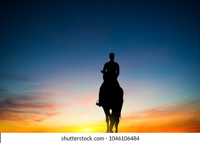 silhouette of the rider against the sunset sky.the journey on horseback.