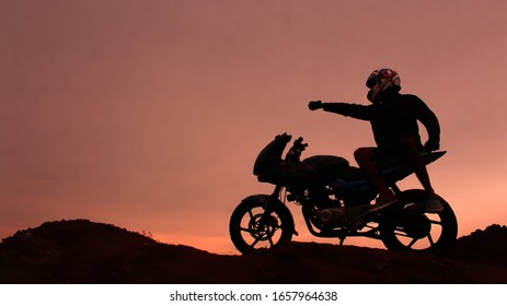 silhouette of a rider and his bike
