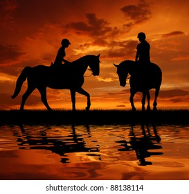 silhouette of a riders on a horse
