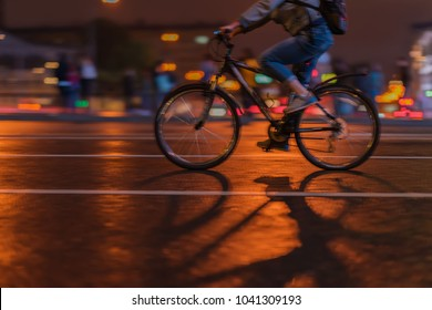 Silhouette of riding Cyclists on the city roadway, night, abstract, motion blur