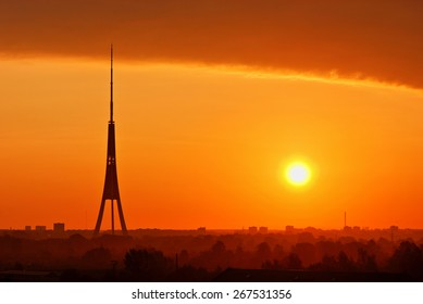 Silhouette of Riga Radio and TV Tower during the sunrise