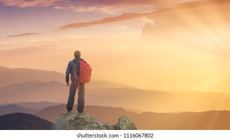 Silhouette of a rock climber at the mountain valley background. Concept of travel and adventure