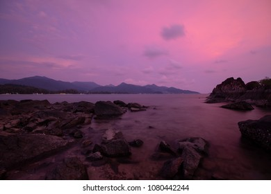 silhouette of rock formations in the sea during Twilight.Long Exposure Photography Technique .Chai Chet, Koh Chang, Trat, Thailand.