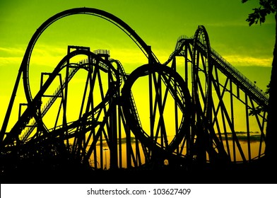 silhouette of a roller coaster at  sunset, after a sunny day
