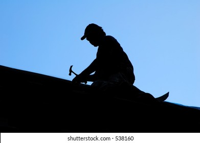 Silhouette of Roofer