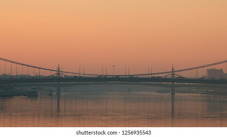 Silhouette of the Royal Palace Budapest and the Elisabeth bridge with orange sky at sunset in Budapest, Hungary. Eastern European capital city skyline.