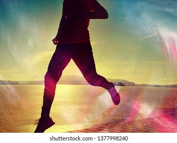 Silhouette of runner person running along on the beach at sunset with sun in the background. Vintage effect style pictures.
