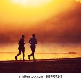 Silhouette of running man at sunrise
