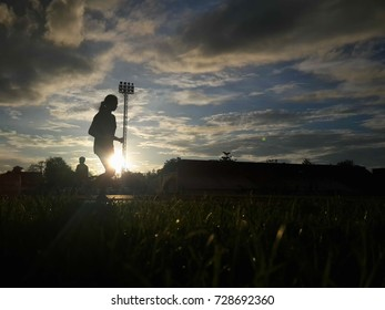 Silhouette  running on road at sunrise. Fitness and workout wellness concept.