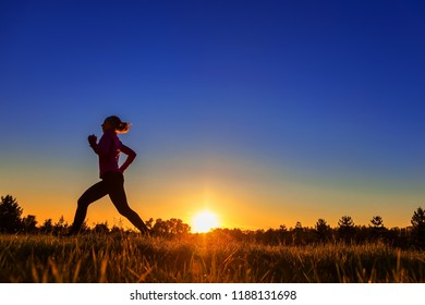 silhouette, running sportswoman in the sun, toning
