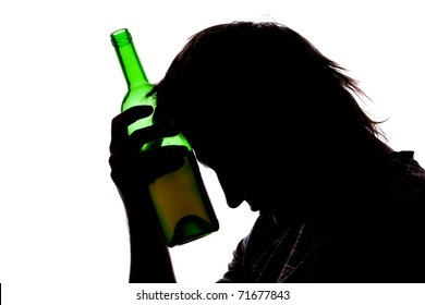 Silhouette of sad man drinking alcohol. Isolated on white