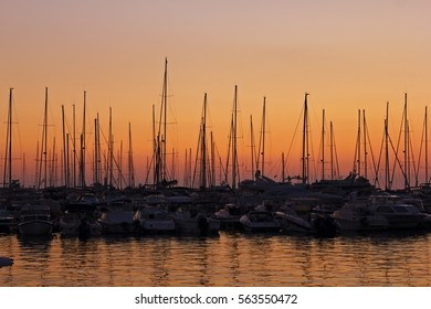 silhouette of sailboats at sunset