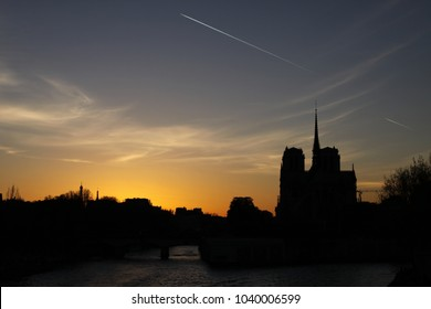 silhouette of The Sainte chapelle the backdrop of the setting sun. France, Paris.
