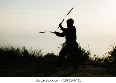 Silhouette of a samurai fighter