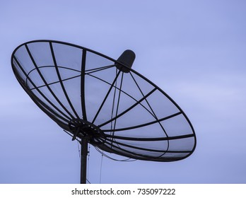Silhouette satellite dish on blue sky background