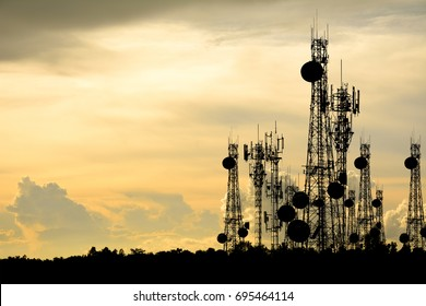 silhouette satellite dish telecom network at sunset communication technology network