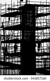 Silhouette of scaffold platform around a pillar in a construction site - early morning sunrise-black and white