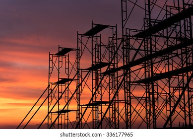Silhouette of scaffolding in the construction site before to night time or sunset time. worker empty.