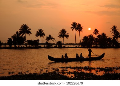 Silhouette scene of a ferryboat from the backwaters of Kerala, India.