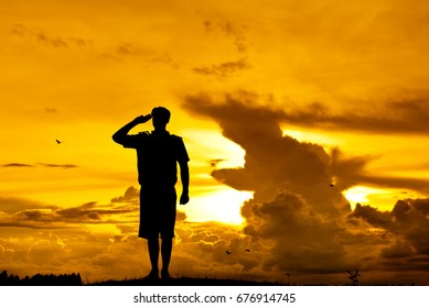 Silhouette Scout director Respect on the mound at sunset.