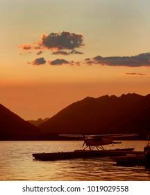 Silhouette of Sea Plane Docked at Stehekin on Lake Chelan at Sunset