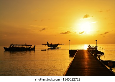 silhouette of sea plane at tropical sunset