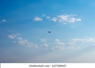Silhouette seaplane on the background of the blue sky. The concept of free life, travel, rest. There's room for your text. Hydroplane in the sky.