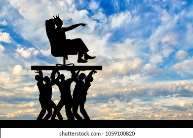 Silhouette of a selfish man with a crown on his head sitting in an armchair, indicates to people who carry him, where to move. The concept of selfish behavior towards other people