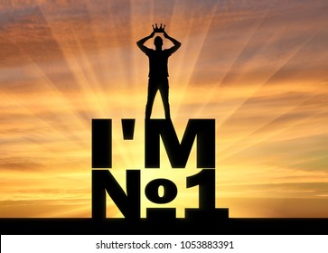 Silhouette of a selfish and narcissistic man, he wears a crown, standing on a word, I'm number one. The concept of selfishness and narcissistic personality