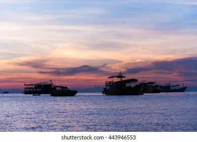 silhouette set of floating boat at sunset