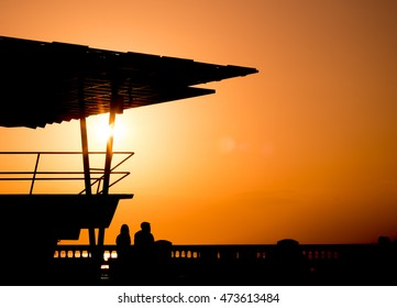 Silhouette ,Shadow of a couple to enjoy Sunset by the sea during the summer vacation .
