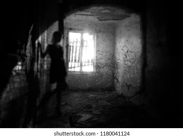 Silhouette shadow of a girl in an abandoned house