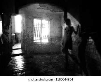 Silhouette of shadow girl in abandoned house (double exposure )
