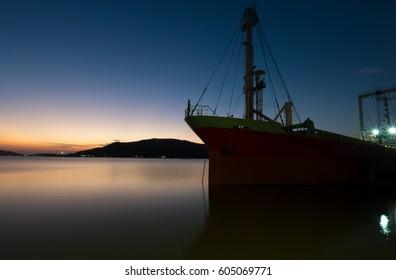 silhouette ship on twilight