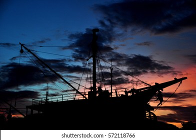 Silhouette of ship with sunset