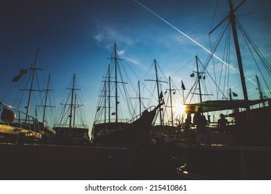silhouette ships at berth on the sea