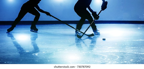 silhouette shot ice-hockey game in winter season game