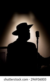 silhouette of a singer and his microphone