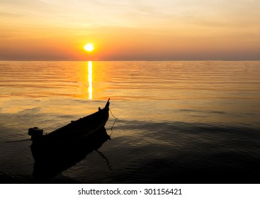 Silhouette of Single Small Ship at The Corner of The Sea in Twilight Time with Beautiful Sunset and Reflection at Pattaya, Thailand used as Template with Copyspace to mock up or input Text