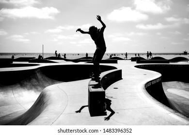 A silhouette of a skateboarder on Venice Beach Skate park, Los Angeles, California