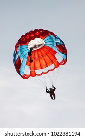 Silhouette skydiver under the canopy of a round sports parachute against the sky, close-up. Parachute jumps. Parachute equipment. Skydiving.