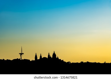 Silhouette of the skyline of Barcelona on top of the Montjuic mountain, Spain.