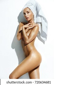 Silhouette of slender naked woman. Photo of woman's body with perfect tanned skin. Wellness and Spa concept