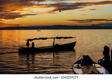 Silhouette of a small traditional boat at dusk in the Albufera in Valencia, a freshwater lagoon and estuary in Eastern Spain.